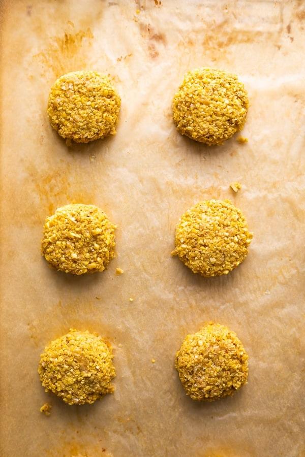 unbaked falafels on baking sheet