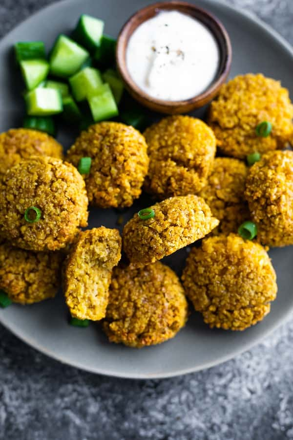baked falafel on plate with dip