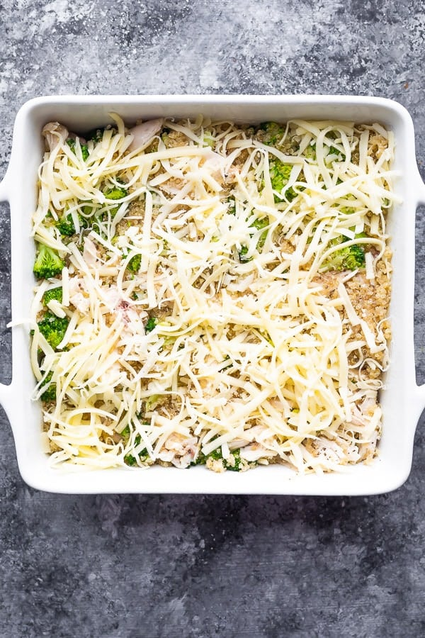 overhead view of chicken broccoli quinoa casserole in baking dish before baking