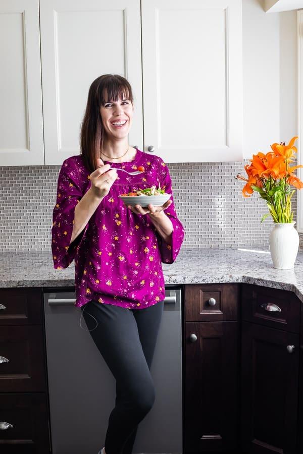 woman eating the caprese salad recipe