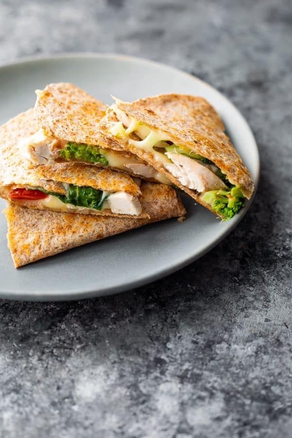 A stack of chicken quesadillas on a gray plate