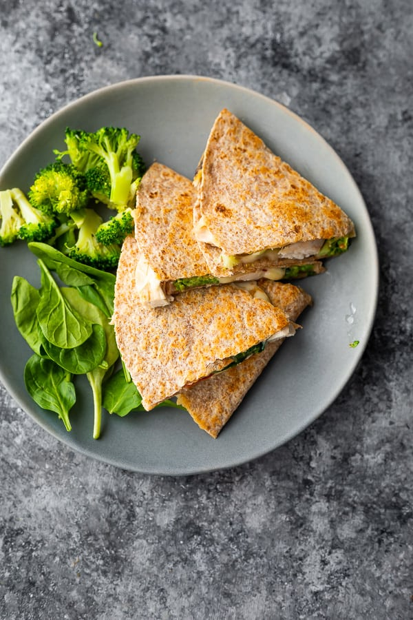 overhead view of healthy quesadilla on plate with vegetables