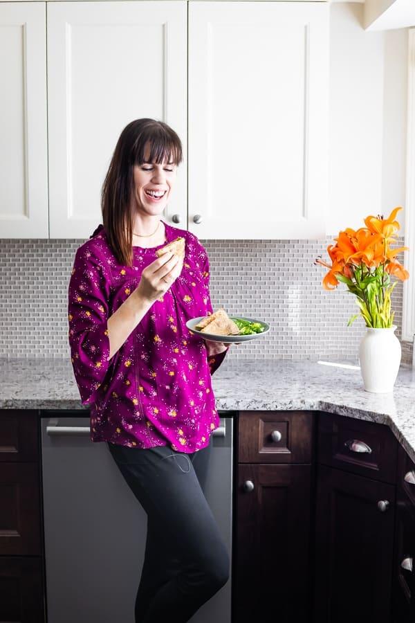 woman eating chicken quesadilla recipe
