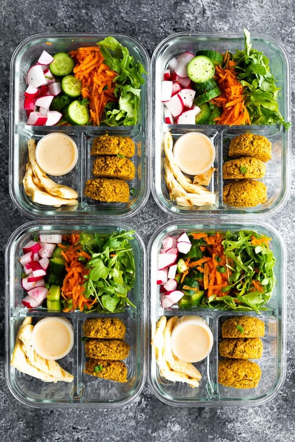 four falafel meal prep bowls in 3 compartment containers