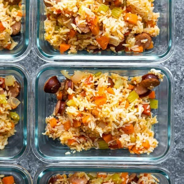 overhead shot of instant pot cajun rice and sausage in multiple glass meal prep containers