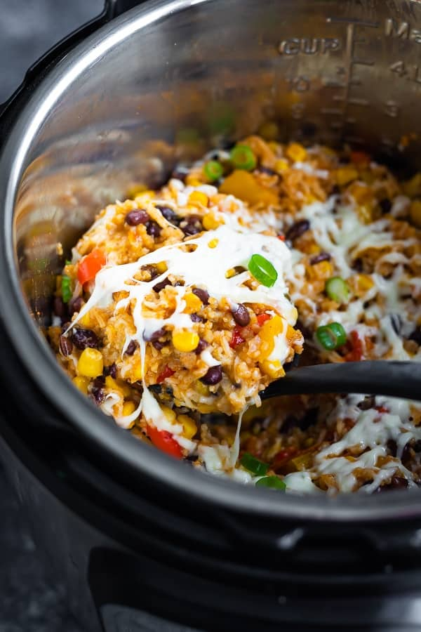 scooping the Instant Pot Fiesta Rice Bowls after cooking