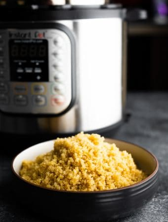 bowl of quinoa in front of an instant pot