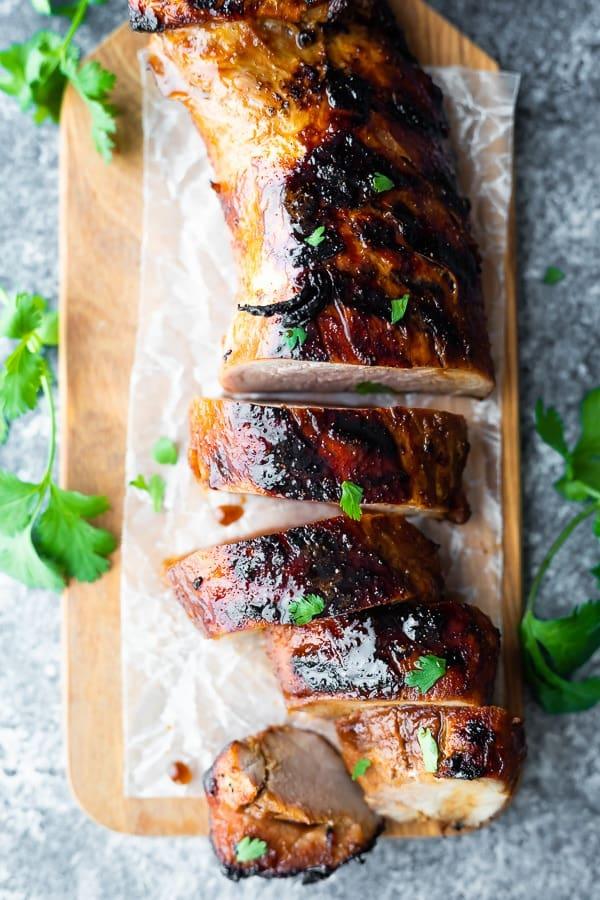 overhead shot of pork tenderloin marinade after cooking on cutting board