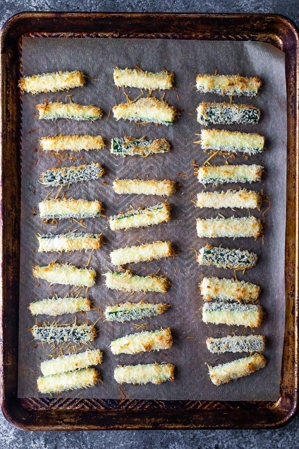 parmesan zucchini fries on baking sheet after baking