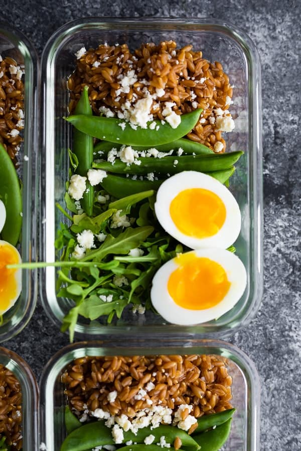 overhead view of arugula salad recipes in meal prep container