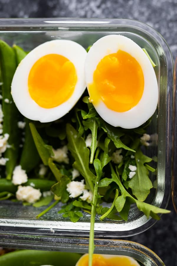 close up view of soft boiled eggs in this farro salad