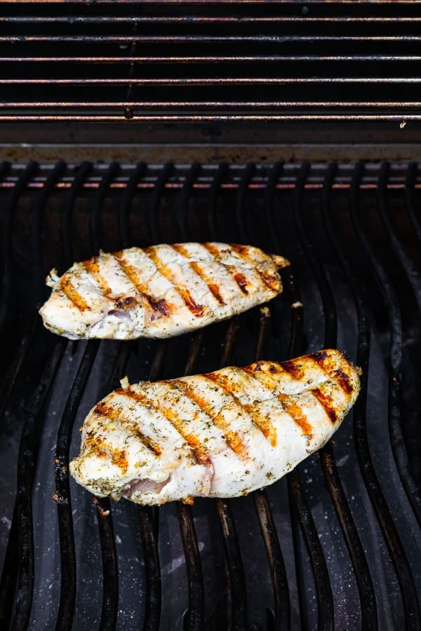 greek chicken recipe cooking on a barbecue