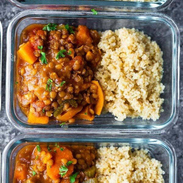 overhead shot of glass meal prep container filled with moroccan instant pot lentils and rice
