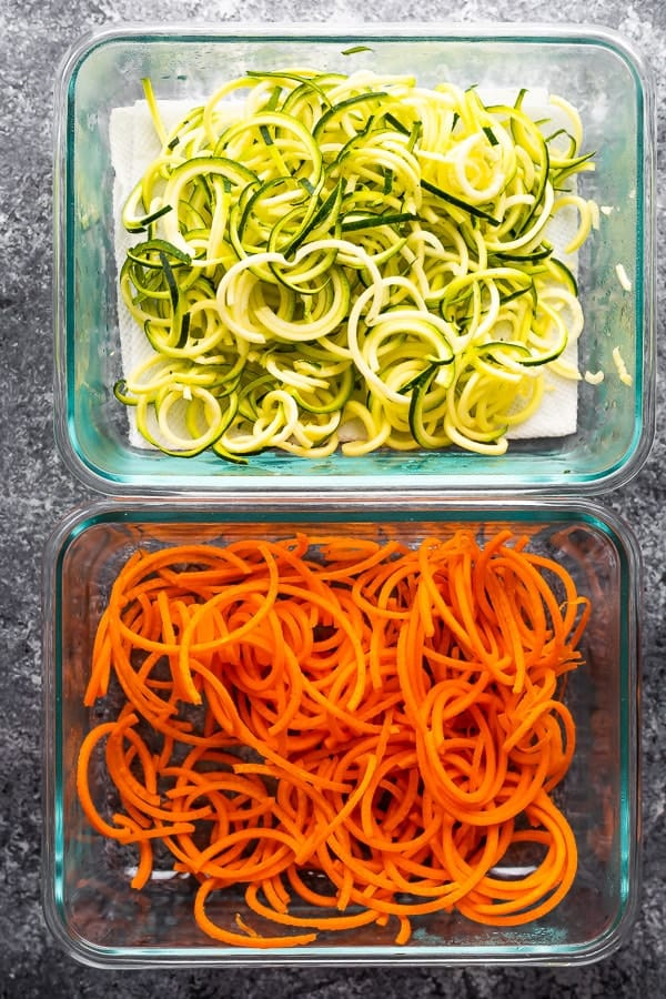 spiralized zucchini and carrots in meal prep containers