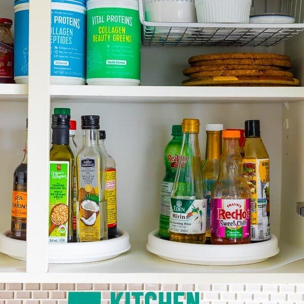 side view of a cabinet with various containers and bottles of pantry items