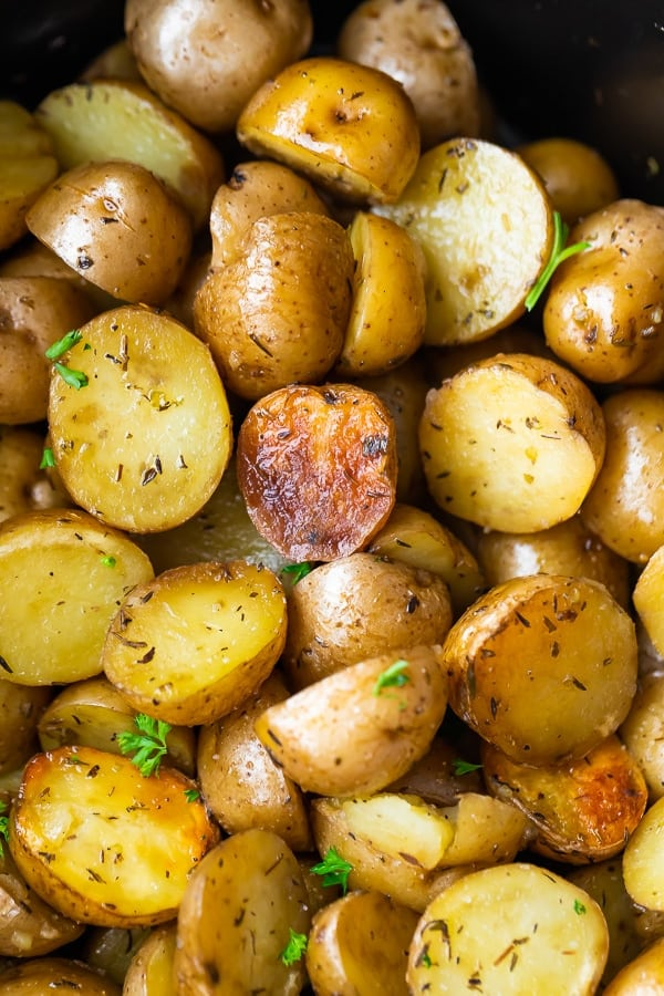 close up of slow cooker potatoes in slow cooker after cooking
