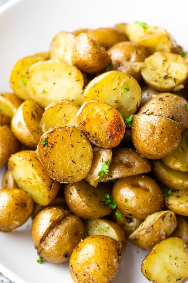 close up of crock pot potatoes on white plate