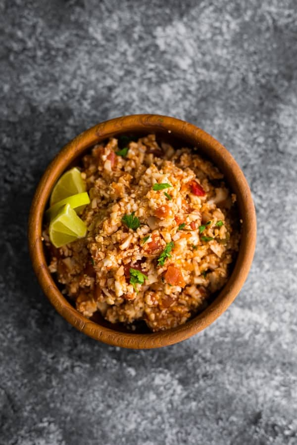 overhead view of mexican cauliflower rice skillet in wooden bowl