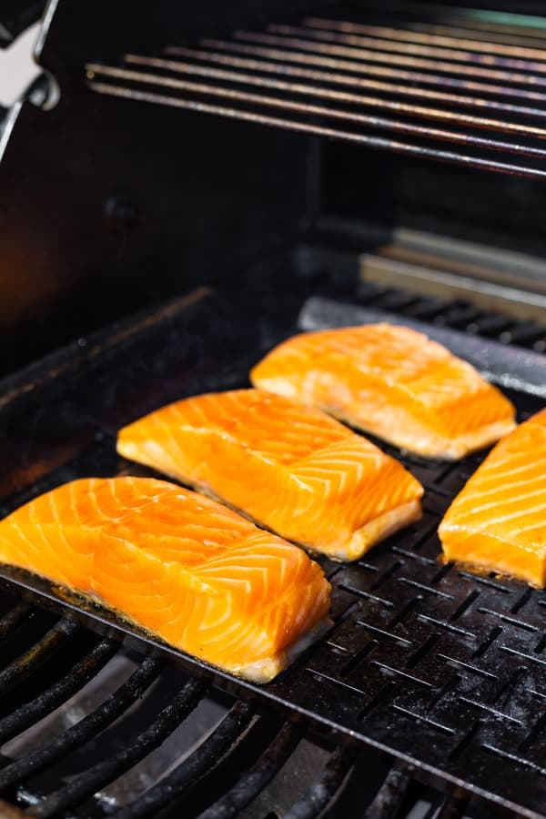 grilling salmon on vegetable grilling plate for the Low Carb Wasabi Grilled Salmon Bowls