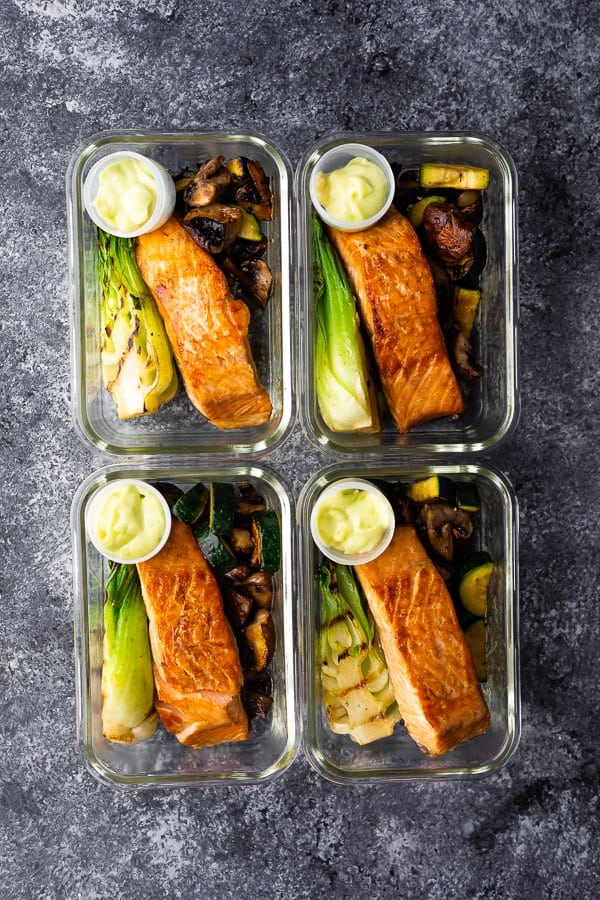 four meal prep containers with Low Carb Wasabi Grilled Salmon Bowls