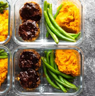 overhead shot of barbecue meatloaf meal prep bowls in glass meal prep containers