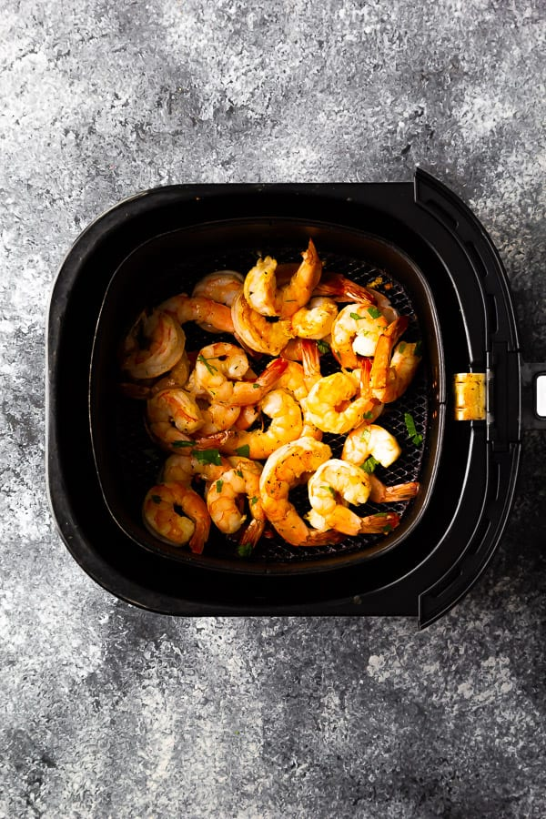 overhead view of air fryer fried shrimp in basket