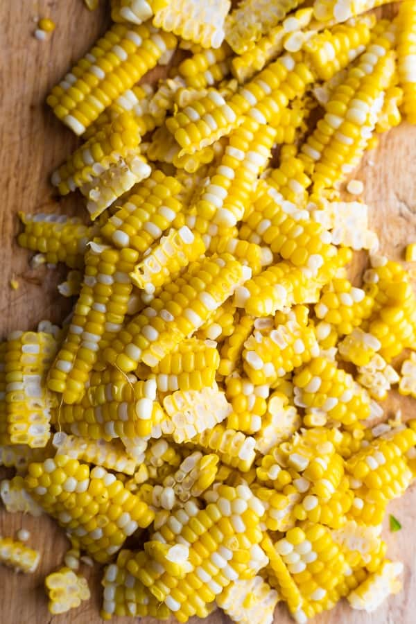 cooked and chopped corn for the black bean corn salad on cutting board