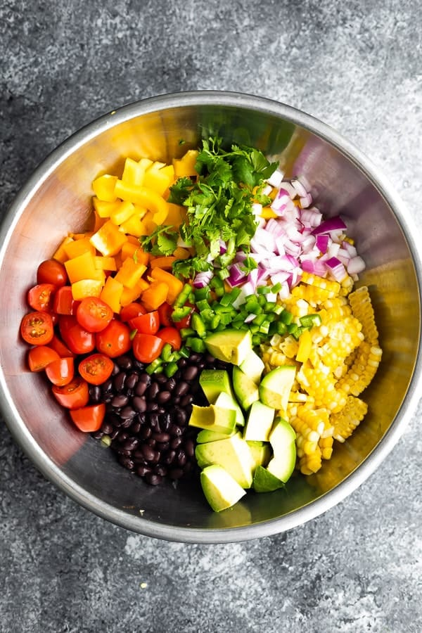 overhead shot of the black bean and corn salad recipe in bowl before tossing