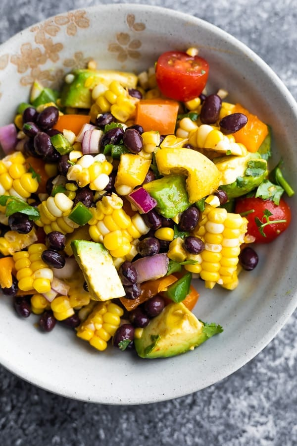 corn and black bean salad recipe in a bowl (after tossing in dressing)