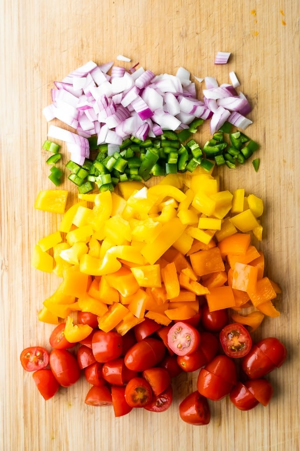 ingredients for the black bean corn avocado salad on cutting board
