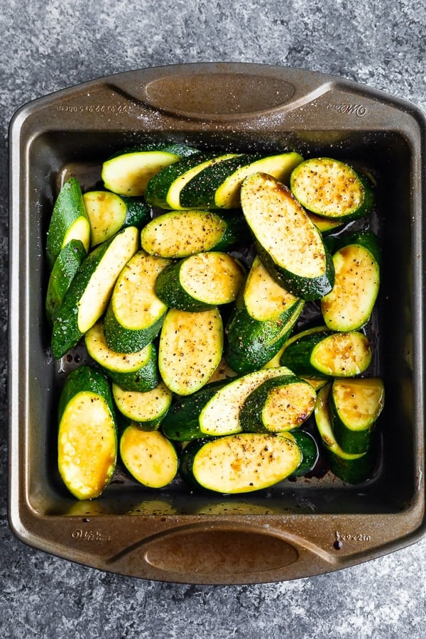 marinating zucchini in baking dish for the grilled zucchini recipe