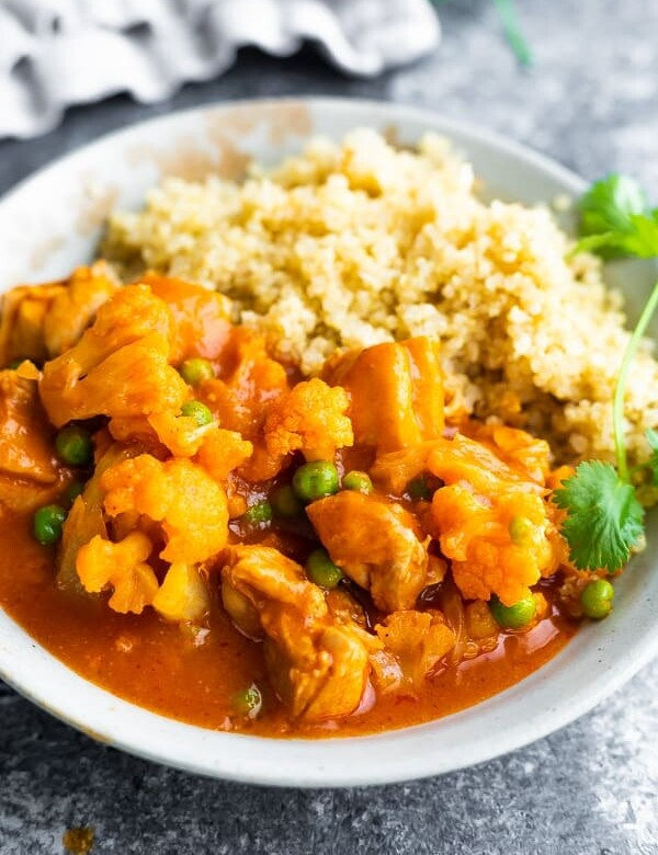 Chicken Tikka Masala with rice in a white bowl