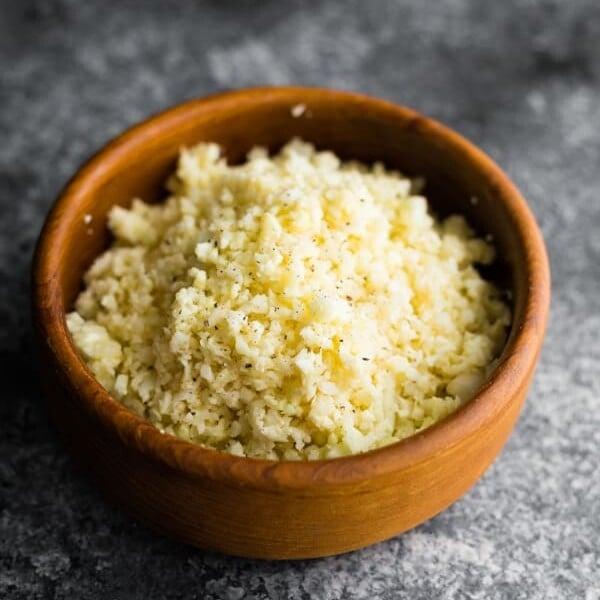 A wood bowl of parmesan cauliflower rice