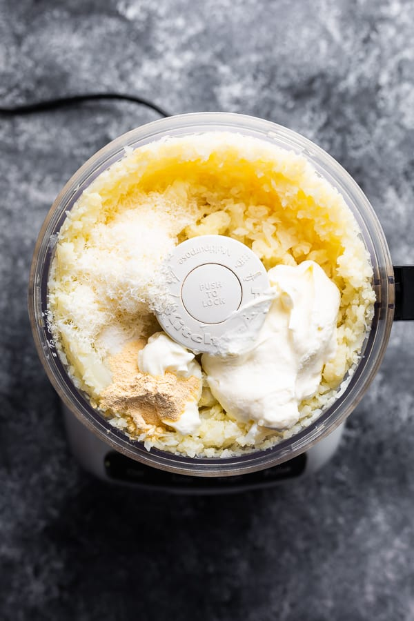overhead view of cauliflower mashed potatoes in food processor