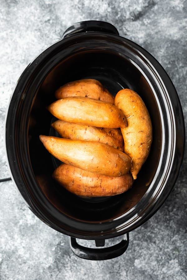 Crockpot sweet potatoes in the slow cooker before cooking