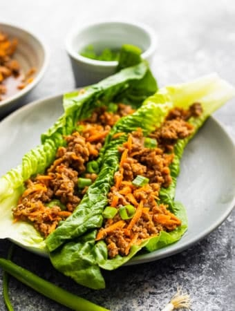 two asian ground turkey lettuce wraps on gray plate