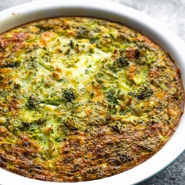 Broccoli cheese crustless quiche in a large white pie plate