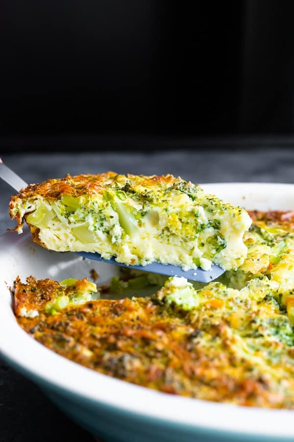slice of crustless quiche recipe on spatula lifting out of pie plate