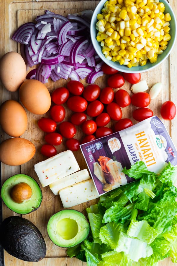 cobb salad ingredients on cutting board