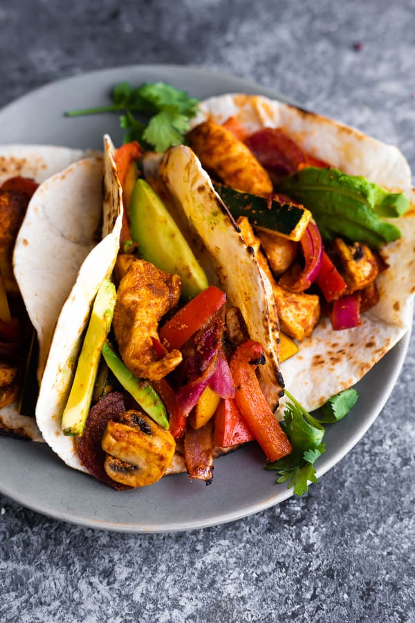 close up view of easy chicken fajitas recipe on plate