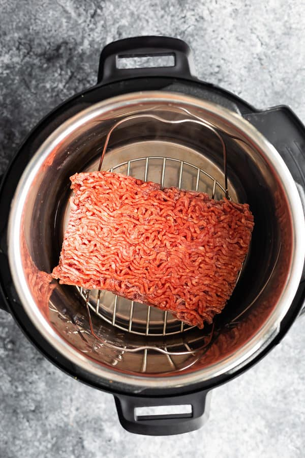 overhead shot of of frozen ground beef in the instant pot
