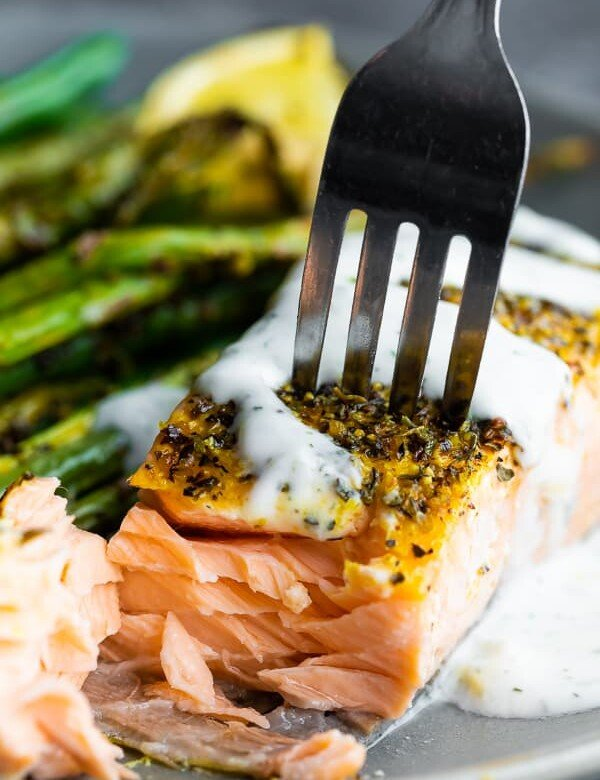 fork taking a bite out of the lemon pepper salmon