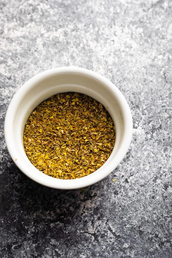lemon herb seasoning in white bowl for the sheet pan salmon