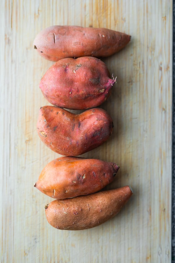 overhead view of sweet potatoes on cutting board for sweet potato mash recipe
