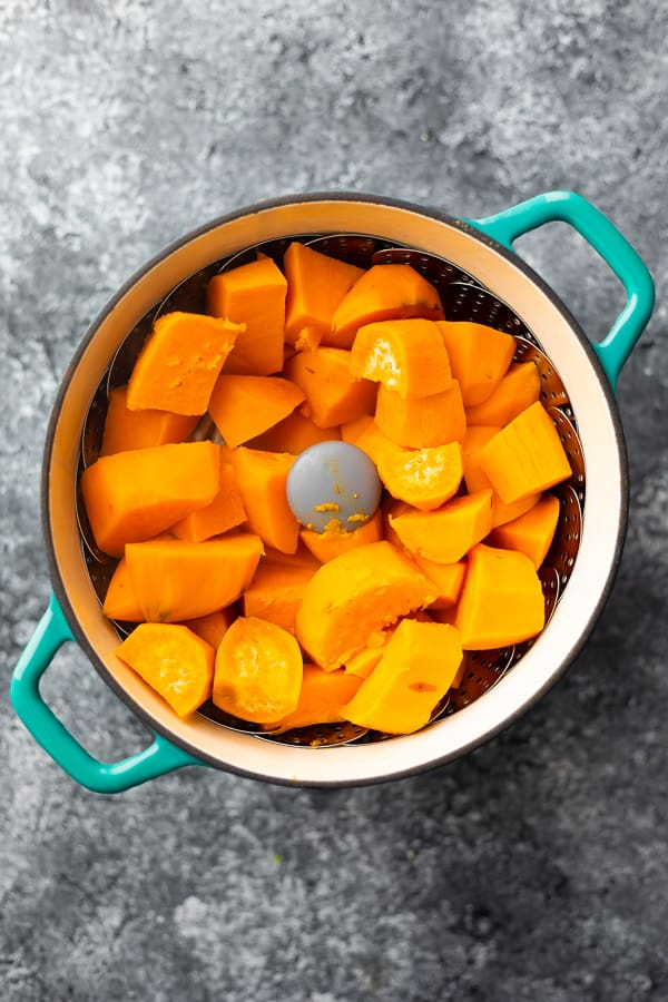 sweet potato chunks in steamer basket after cooking for mashed sweet potatoes