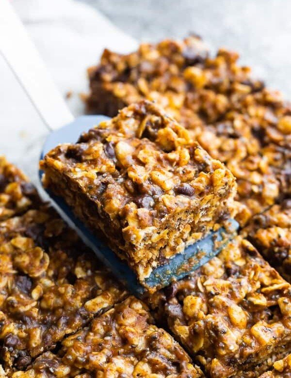 a spatula picking of a slice of no bake snack bars