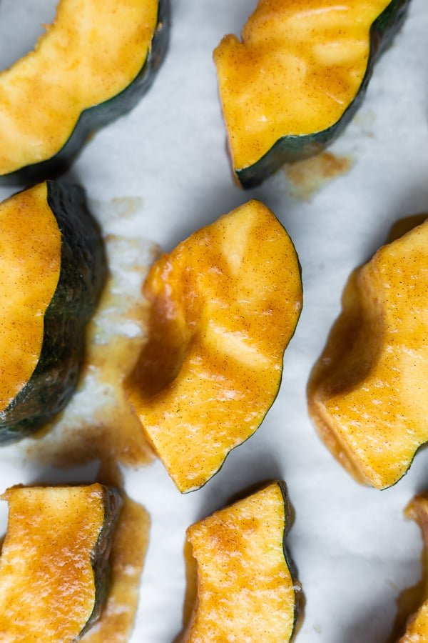overhead view of roasted acorn squash recipe on baking sheet