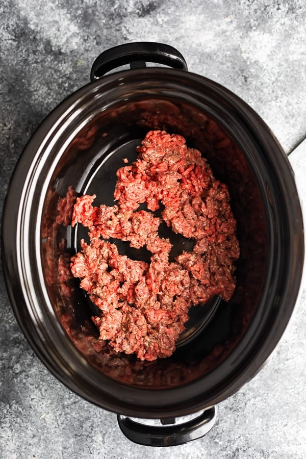 ground beef in slow cooker before adding other easy taco soup ingredients