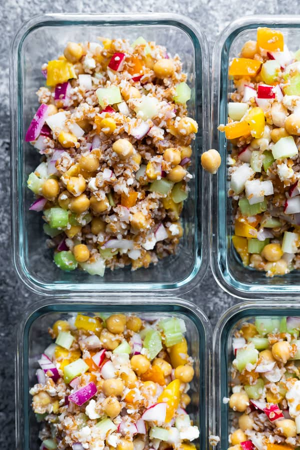 bulgur salad divided between four meal prep containers
