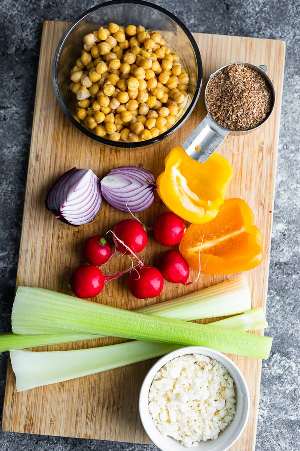 overhead view of chickpea salad recipe ingredients on cutting board